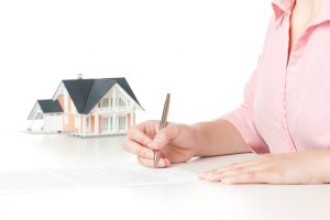 Woman confirm mortgage contract (estate agency client sign contract)